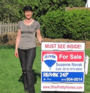 Susanne Novak Broker with REMAX for sale sign